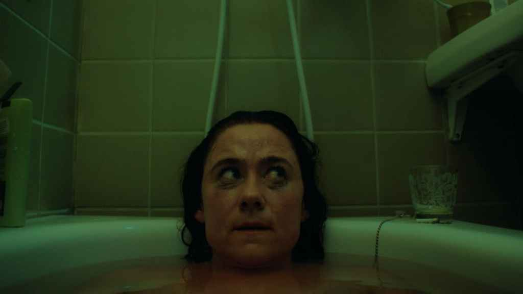 Molly (Cecilia Milocco) in the bathtub with running make-up.
