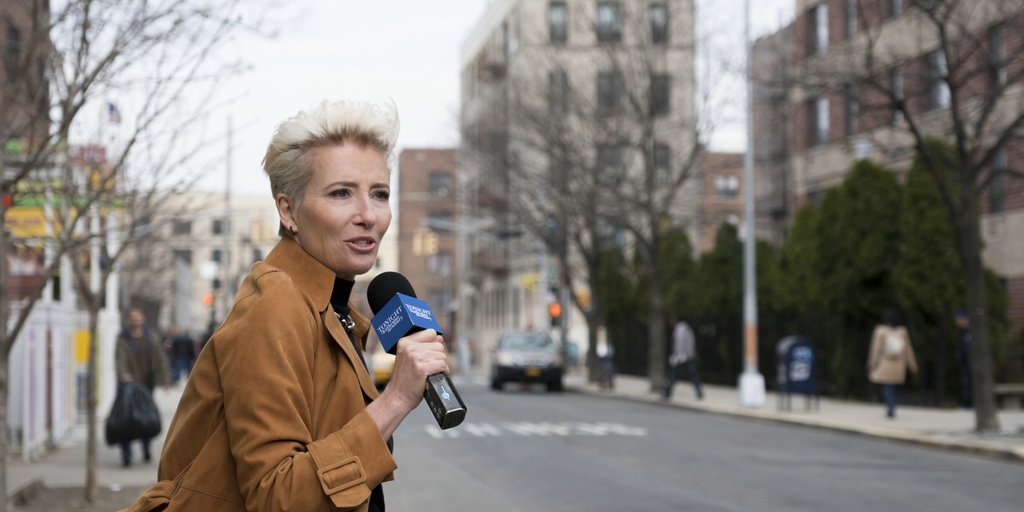 Katherine (Emma Thompson) on the street, microphone in hand.