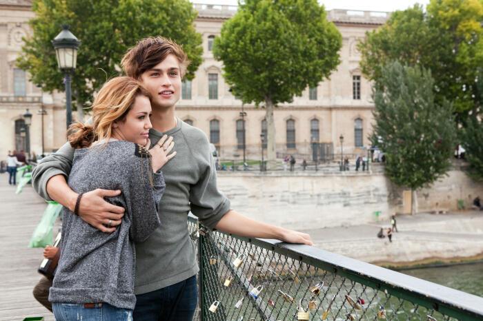 Lola (Miley Cyrus) hugging her best friend Kyle (Douglas Booth) in Paris.