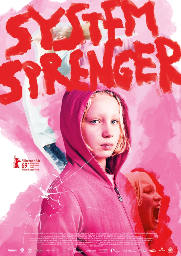 The film poster showing Benni (Helena Zengel) in a pink hoodie, looking seriously. Behind that, smaller, we can see her twice, once spreading her arms as if flying or falling, and once screaming.