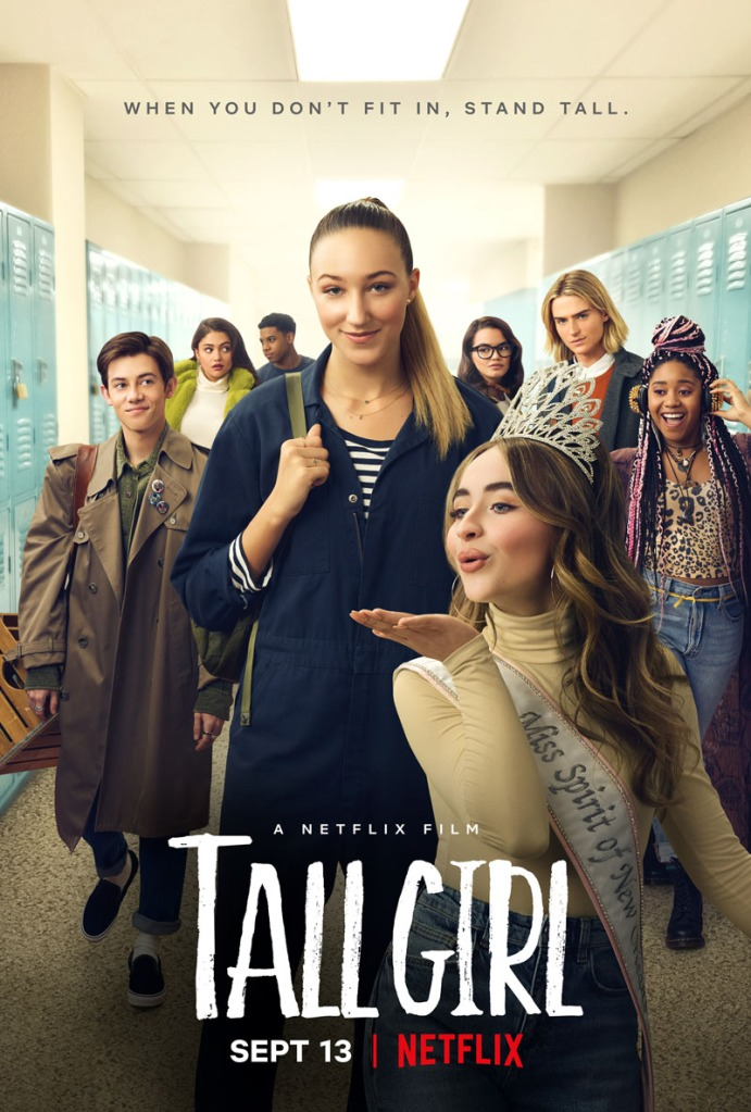 The film poster showing Jodi (Ava Michelle) surrounded by all her school friends, taller than everybody else.