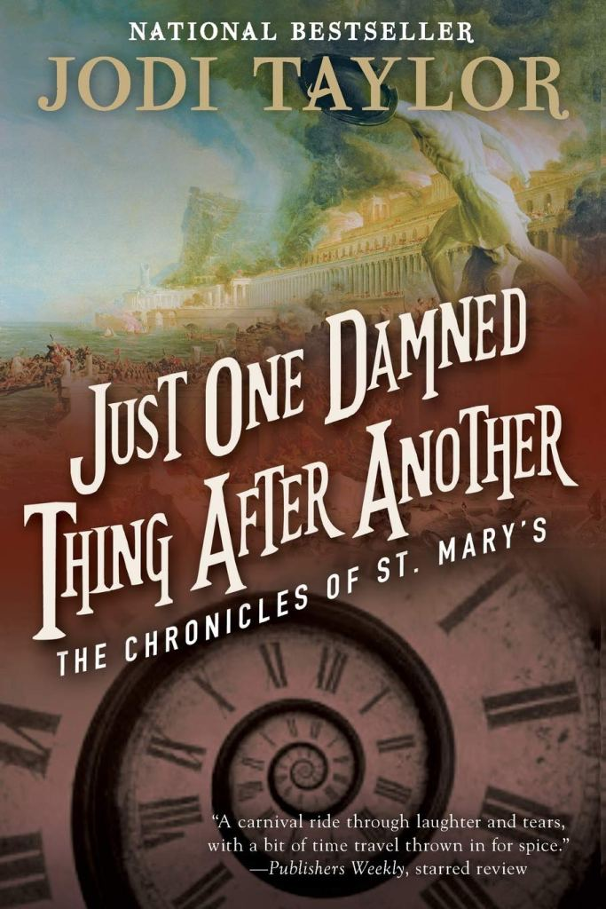 The book cover showing a burning antique city and a watchface that is not a circle but a spiral.