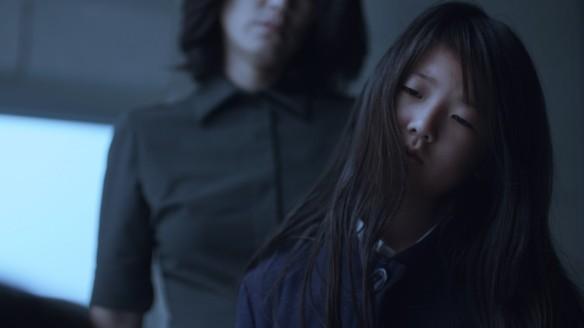 Jules (Samantha Kim) looking critically at something.