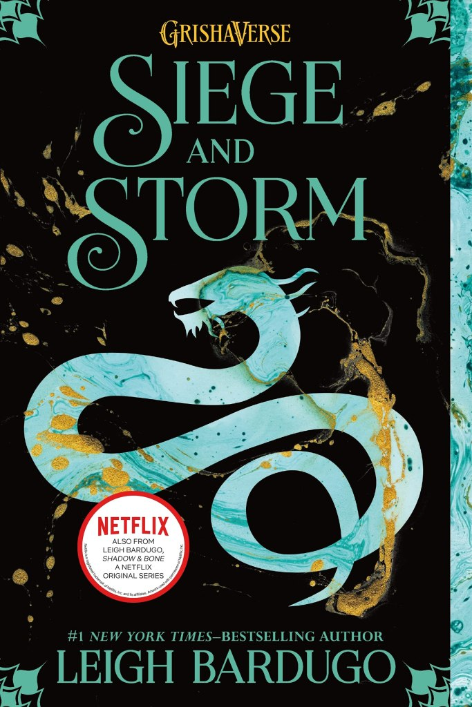 The book cover showing a snakelike dragon in shades of turquoise on black background. Golden drops cover the page.