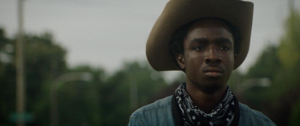 Cole (Caleb McLaughlin) wearing a cowboy hat.