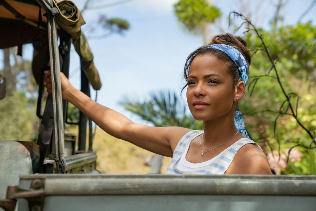 Gabriela (Christina Milian) in a car, looking at something,