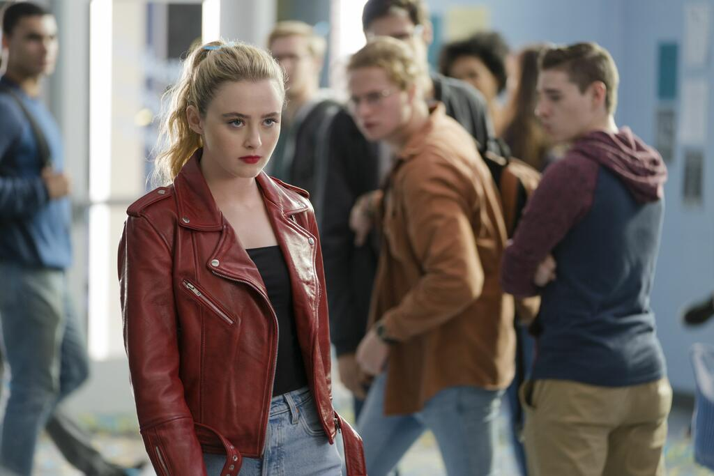 The Butchter in Millie's body (Kathryn Newton) striding confidently through school.