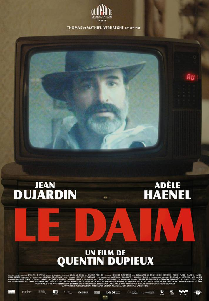 The film poster showing an old TV set that's showing Georges (Jean Dujardin) in a cowboy hat.