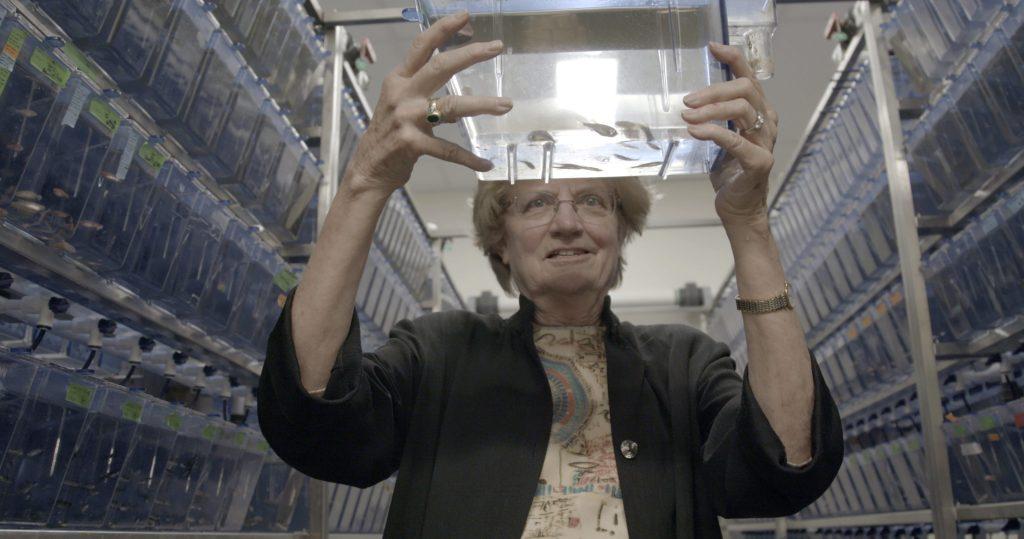Nancy Hopkins holding up an aquarium.