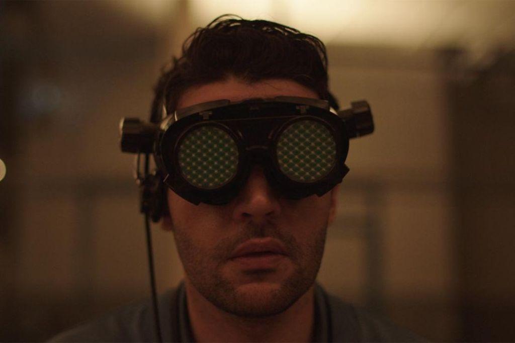 Colin (Christopher Abbott) wearing futuristic goggles.