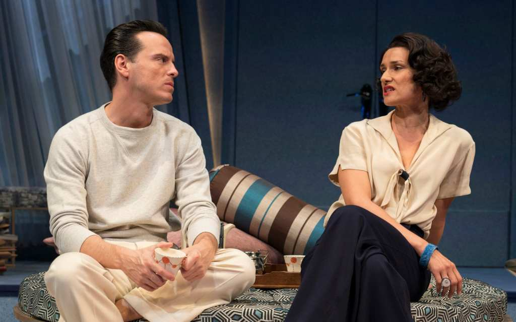 Garry (Andrew Scott) talking to Liz (Indira Varma), both with serious to almost disgusted facial expressions.