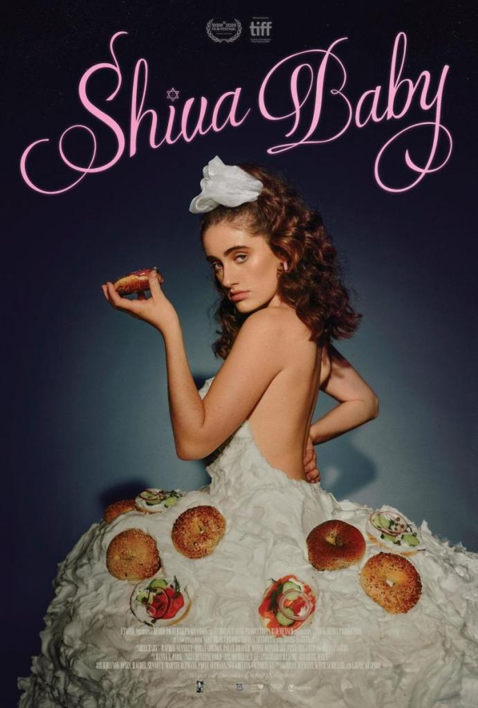 The film poster showing Danielle (Rachel Sennott)in a dress made of cream cheese and bagels, holding up a bagel.