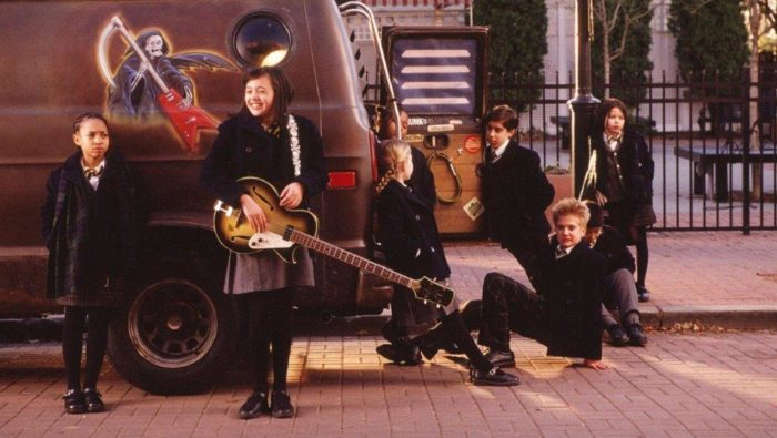 The kids from the band hanging around Dewey's van.