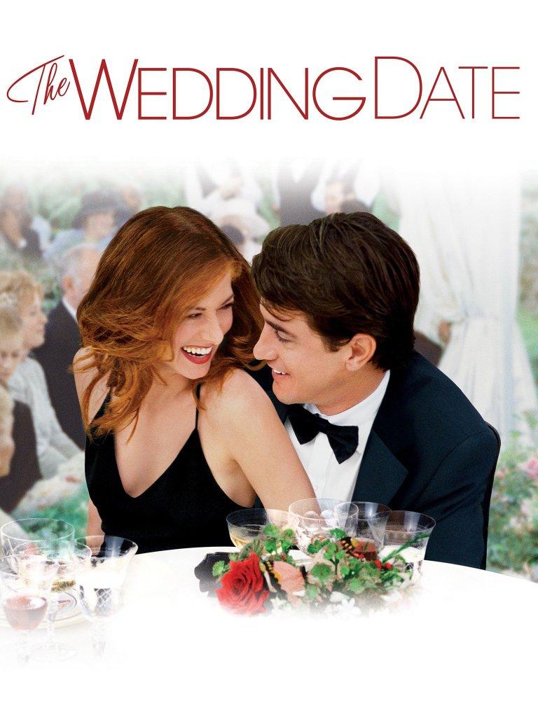 The film poster showing Kat (Debra Messing) sitting in Nick's (Dermot Mulroney) lap at a wedding, both laughing.