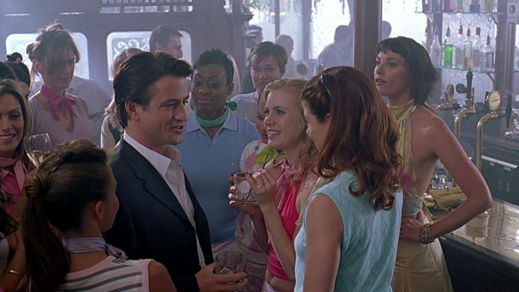Nick (Dermot Mulroney) wooing Amy (Amy Adams) and her bridesmaids.