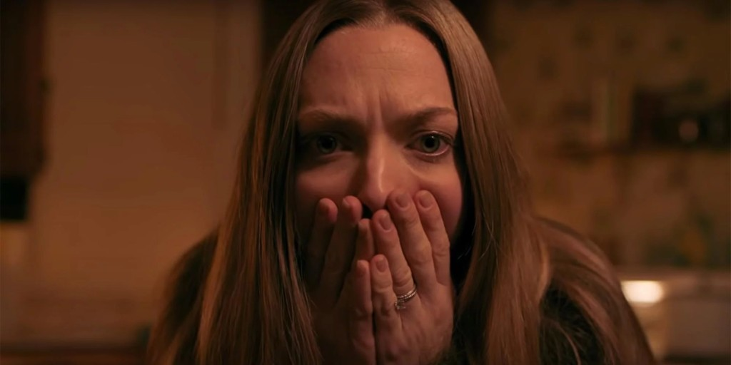 Catherine (Amanda Seyfried) covering her mouth in horror.