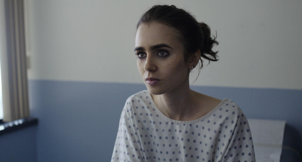 Ellen (Lily Collins) at the doctor's office.