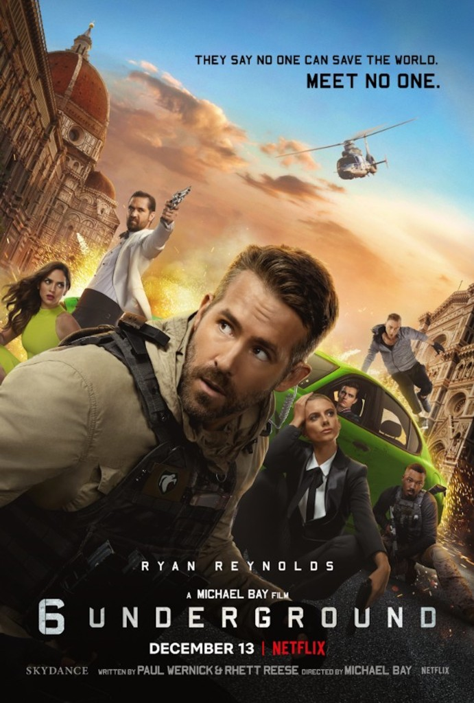 The film poster showing the 7 recruits in various action poses, with One (Ryan Reynolds) taking the center.