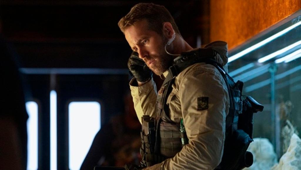 One (Ryan Reynolds) in full combat uniform.