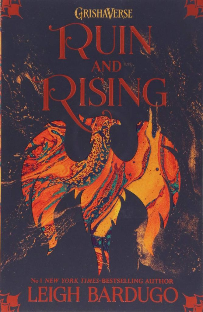 The book cover showing the shape of a phoenix or firebird in red colors on a black background.
