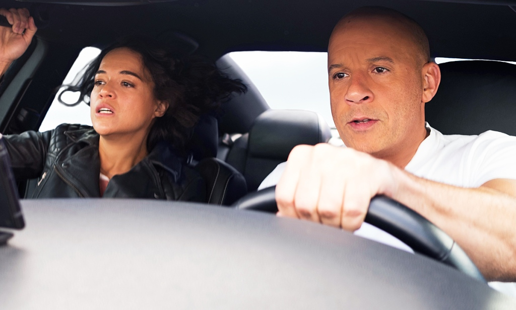 Dom (Vin Diesel) and Letty (Michelle Rodriguez) driving a car at high speed.