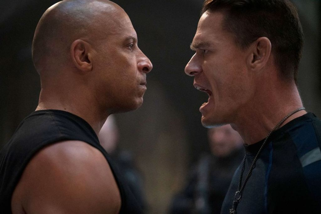Dom (Vin Diesel) and his brother Jacob (John Cena) facing each other angrily.