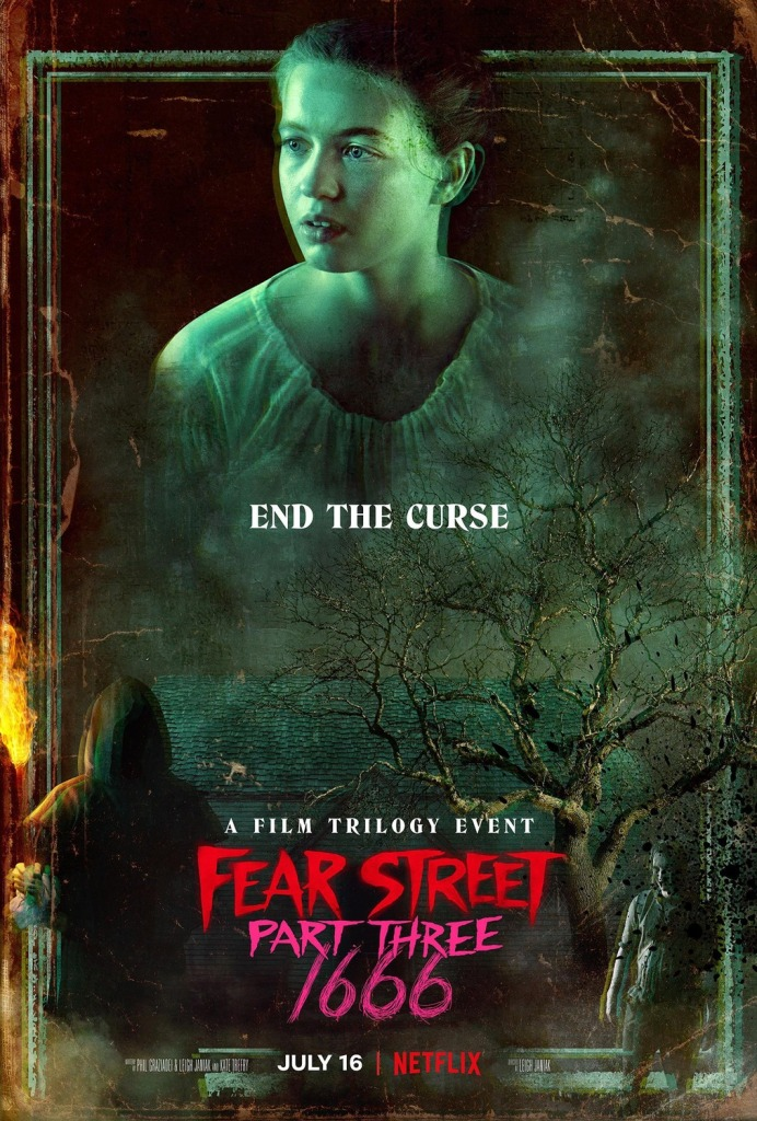 The film poster showing Hannah/Sam (Olivia Scott Welch) tinted in green above a tree, a hooded figure carrying a torch and Solomon Goode (Ashley Zukerman).