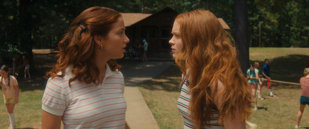 Cindy (Emily Rudd) and Ziggy (Sadie Sink) arguing at the camp.