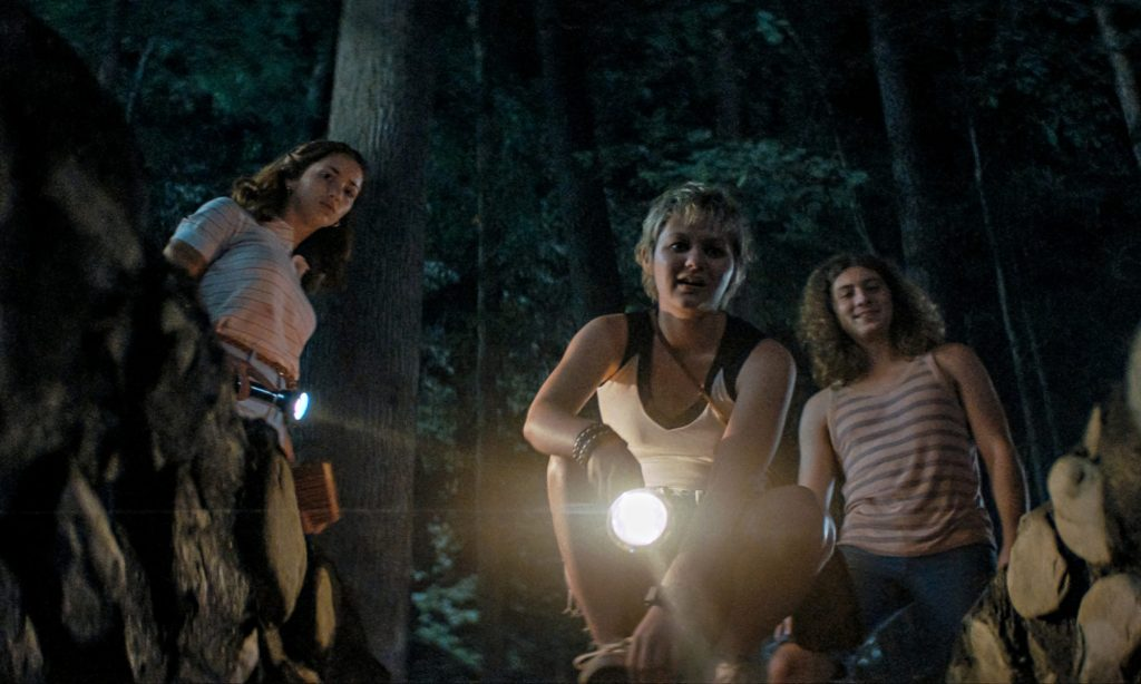 Cindy (Emily Rudd), Alice (Ryan Simpkins) and Arnie (Sam Brooks) looking down a hole.