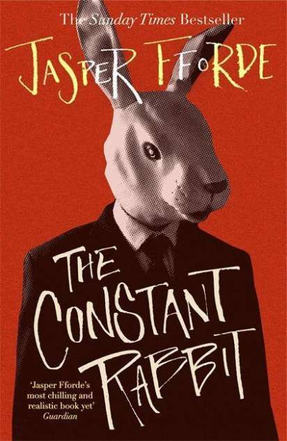 The book cover, shwoing a white rabbit in a business suit in front of a red background.