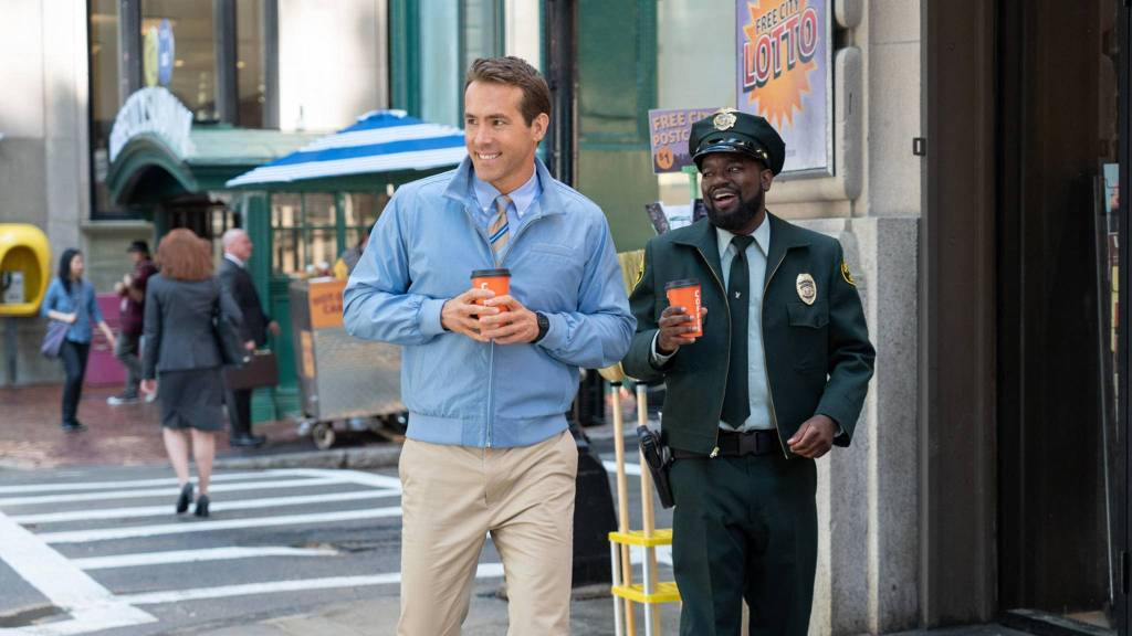 Guy (Ryan Reynolds) and Buddy (Lil Rel Howery) on their way to work.