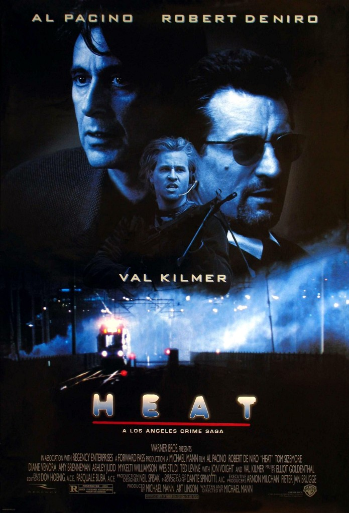 The film poster showing Vincent (Al Pacino), Neil (Robert De Niro) and Chris (Val Kilmer) in black and blue, above an image of a train at night.