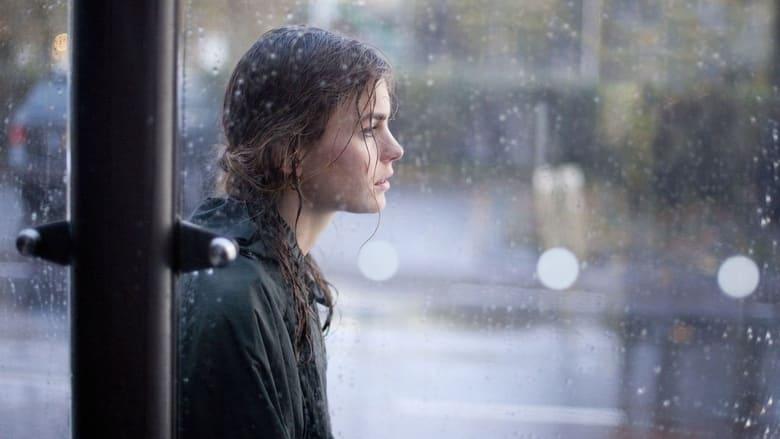 Hemel (Hannah Hoekstra) standing in the rain.