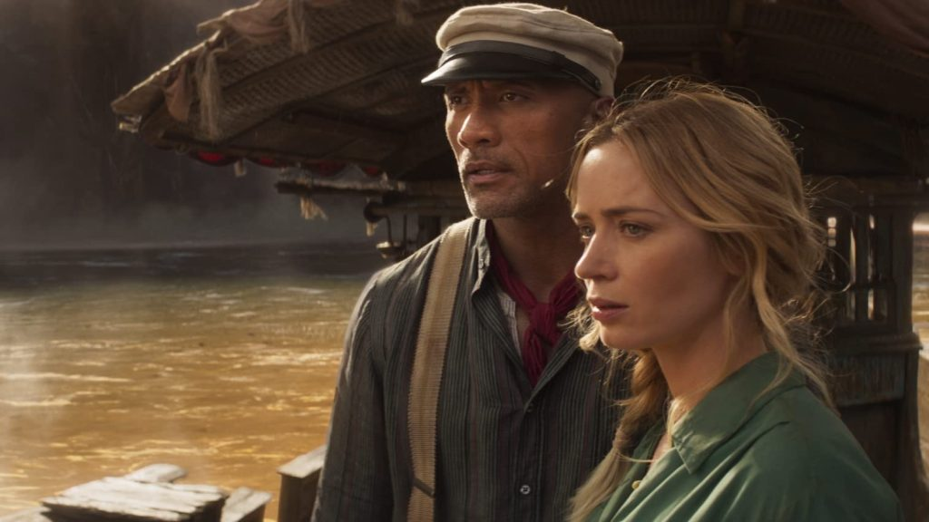 Frank (Dwayne Johnson) and Lily (Emily Blunt) on Frank's boat, looking intently at something.