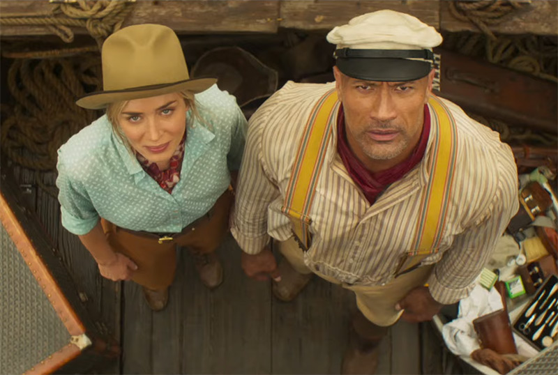 Frank (Dwayne Johnson) and Lily (Emily Blunt) looking upwards at the camera.