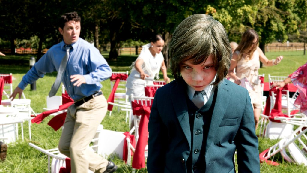 Lucas (Owen Atlas) standing stock-still and lookig scary while behind him a wedding party descends into mayhem.