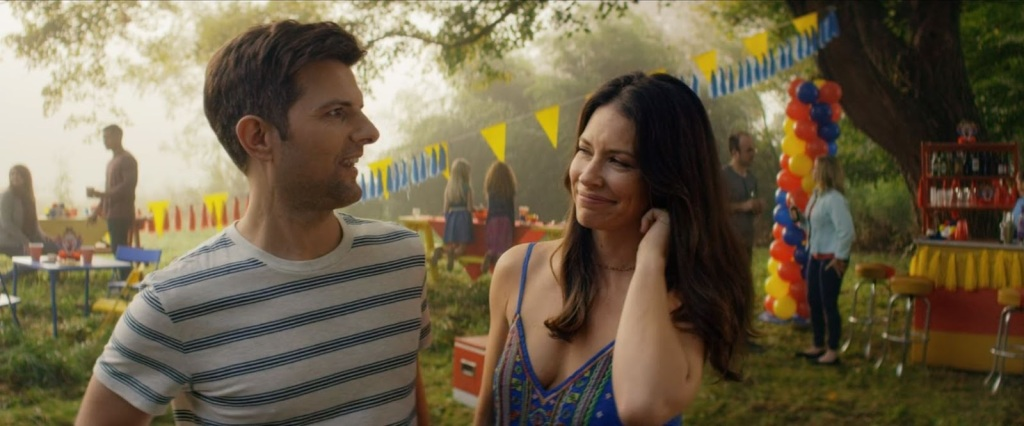 Gary (Adam Scott) and Samantha (Evangeline Lilly) at a children's birthday party, smiling at each other.