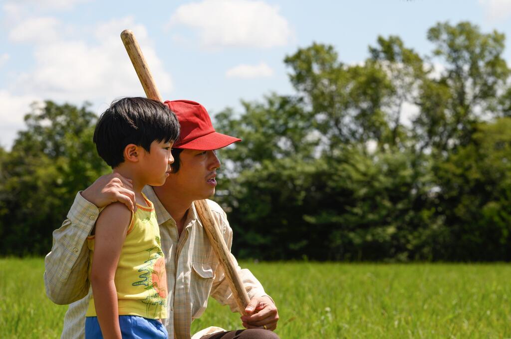 Jacob (Steven Yeun) sharing his wisdom aout farming with David (Alan S. Kim).