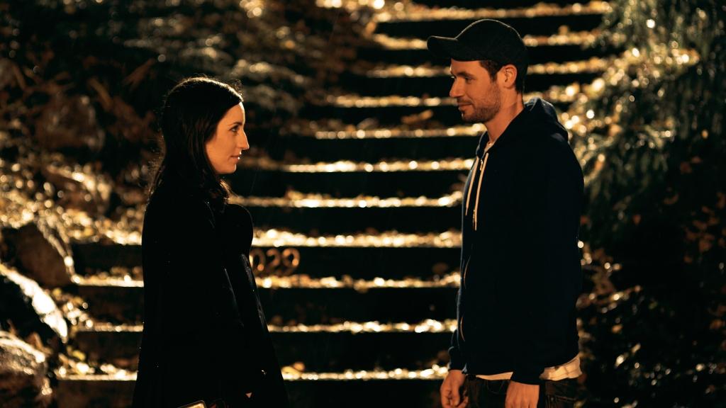 Casper (Sam Rosen) and Rebecca (Zoe Lister-Jones) trying to say good-bye.