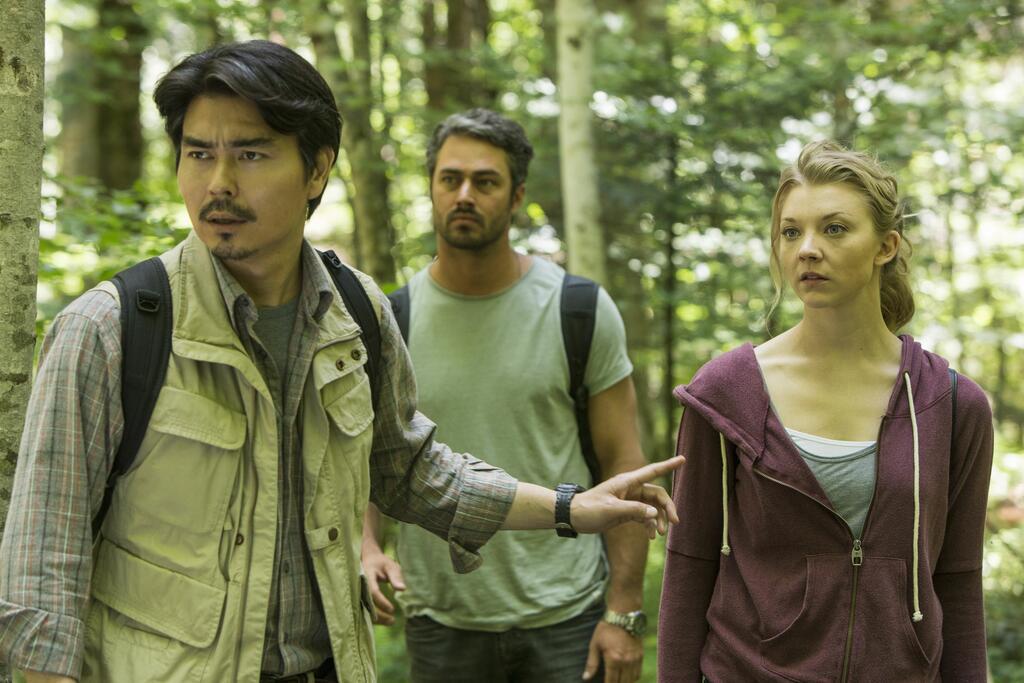 Michi (Yukiyoshi Ozawa) leading Sara (Natalie Dormer) and Aiden (Taylor Kinney) through the forest.