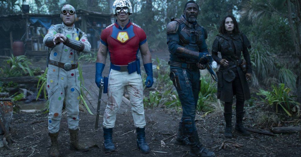 Polka-Dot Man (David Dastmalchian), Peacemaker (John Cena), Bloodsport (Idris Elba) and Ratcatcher 2 (Daniela Melchior) in a camp in the jungle.