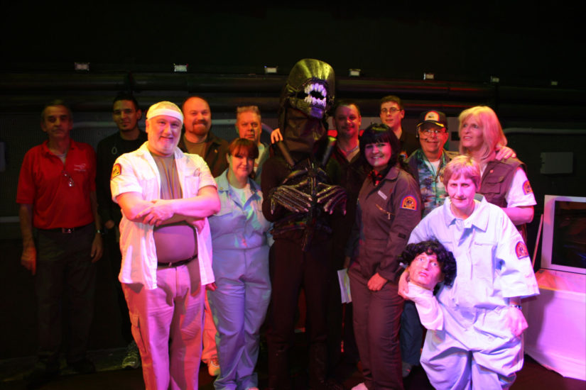 A photo of the cast and crew of the play in, the cast in costume.
