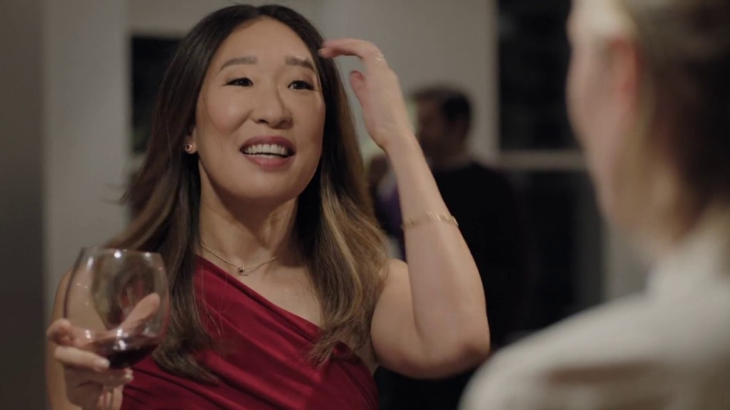 Vanessa (Sandra Oh) smiling with a drink in hand.