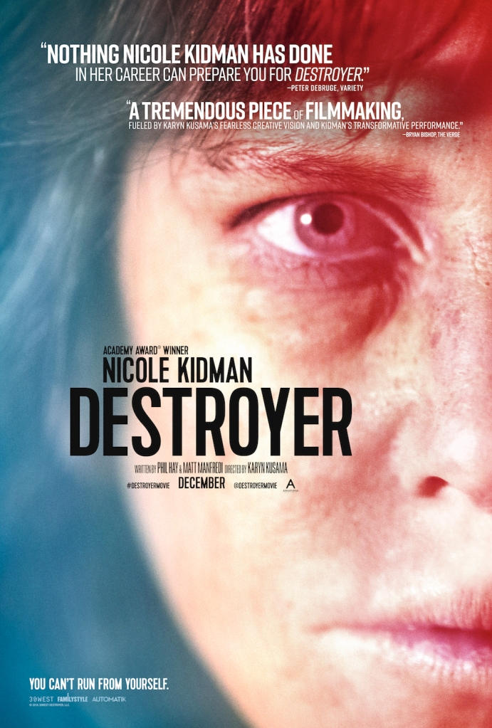 The film poster showing a close-up of half of Erin's (Nicole Kidman) face with deep shadows under her eyes in blue and red light.