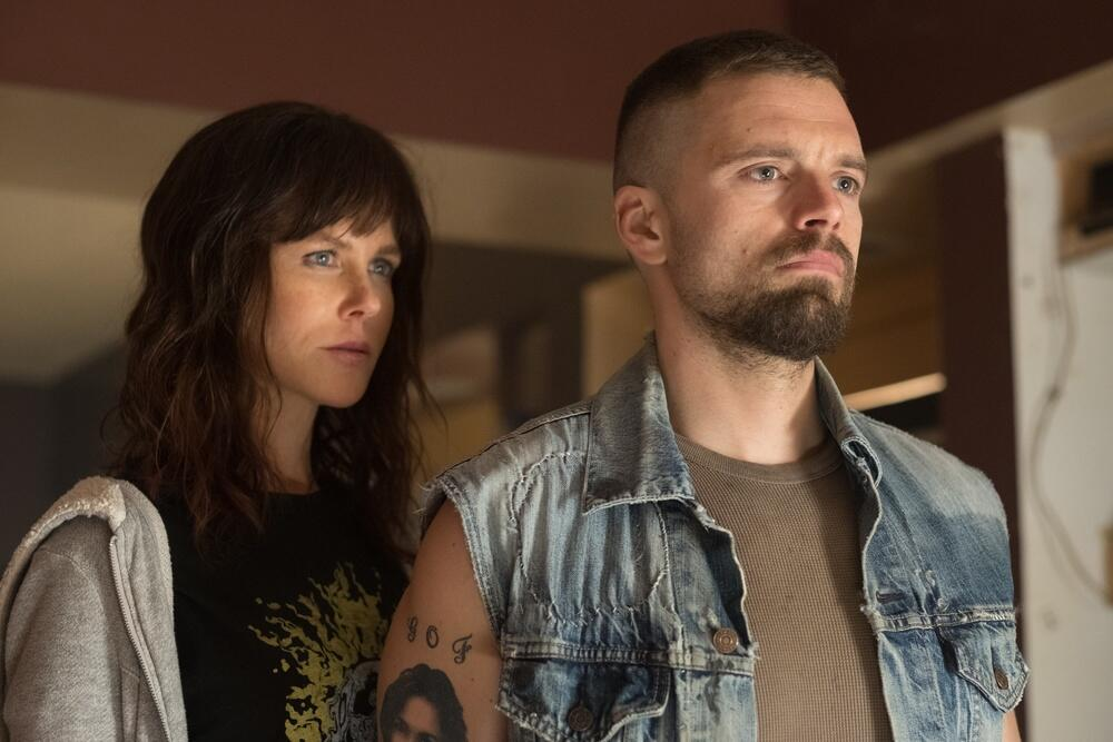 Erin (Nicole Kidman) and her undercover partner Chris (Sebastian Stan) standing close together, their expressions fierce.