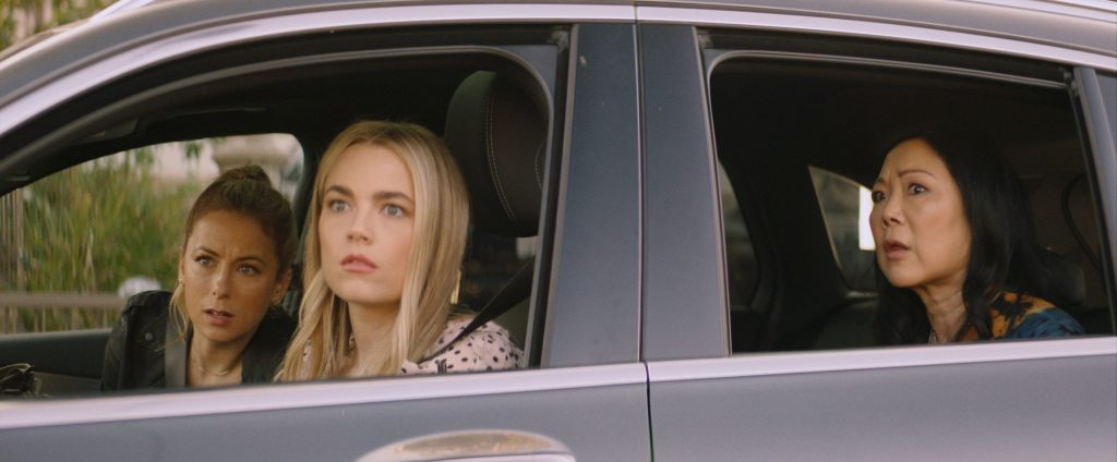 Andrea (Iliza Shlesinger), Serrena (Rebecca Rittenhouse) and Margot (Margaret Cho) in a car, staking something out.