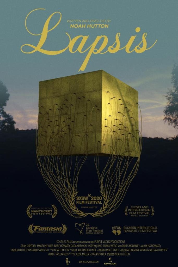 The film poster showing a big golden cube with various cables potruding from it.