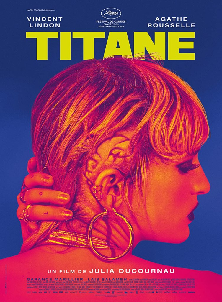 The film poster showing Alexia (Agathe Rousselle) pushing back her hair to reveal a large, snail-shaped scar behind her ear.