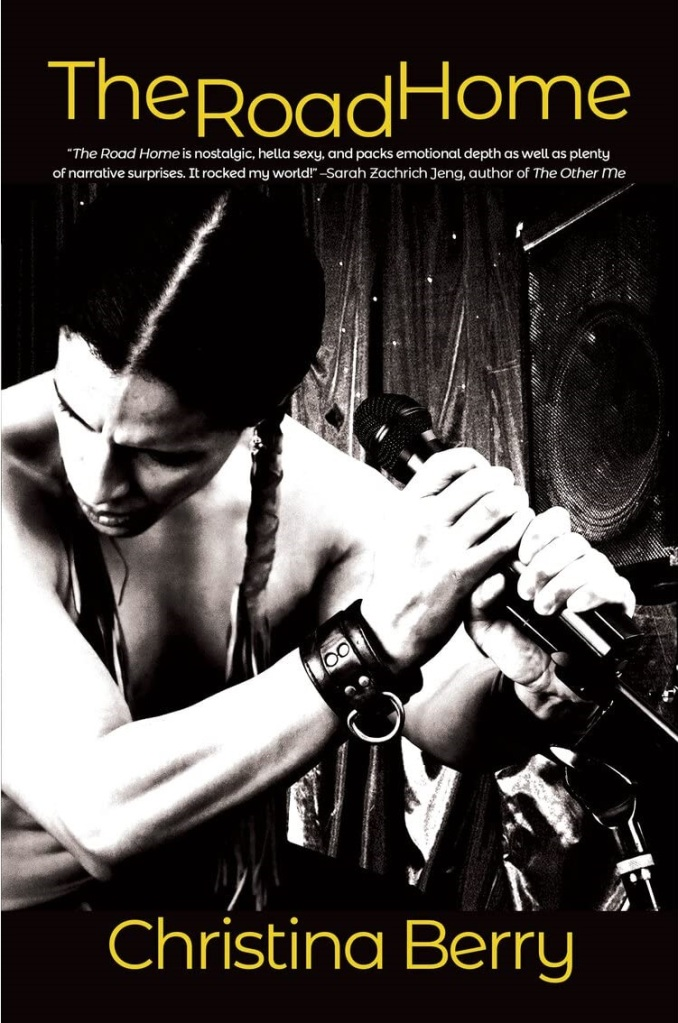 The book cover showing a shirtless Native Americam man with long braids holding a microphone.