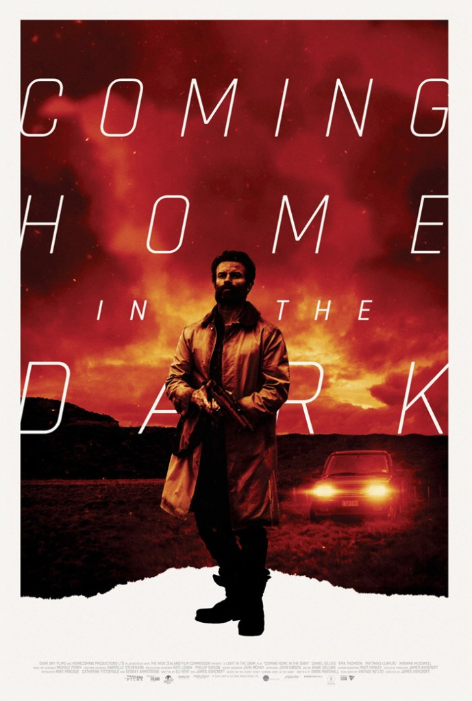 The film poster showing Mandrake (Daniel Gillies) holding a shotgun in front of a red-tinted sky and a car standing in a field.